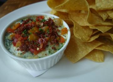 This Rich Spinach And Artichoke Dip Is All Kinds Of Cheesy